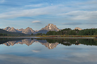 Mount Moran reflected in still waters of the Snake River at Oxbow Bend at sunrise, Grand Teton National Park Wyoming