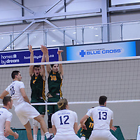1st year right-side hitter Matthew Aubrey (7) of the Regina Cougars and 1st year middle Conal McAinsh (10) of the Regina Cougars in action during the Men's Volleyball Home Game vs Trinity Western  on October 28 at the CKHS University of Regina. Credit Matt Johnson/Arthur Images