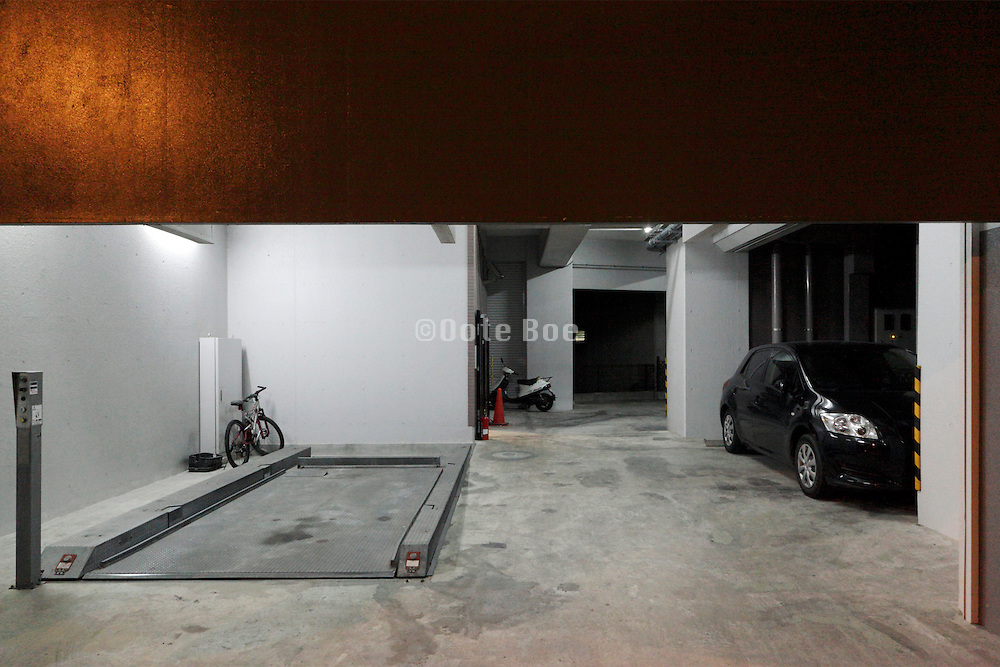 entrance of a new indoor parking garage on the ground floor of a luxurious residential apartment complex