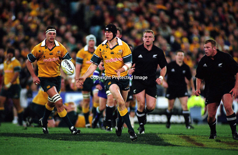 Stephen Larkham in action during the rugby union Bledisloe Cup match between the All Blacks and Australia, Syndey, 3 August 2002. Photo: PHOTOSPORT