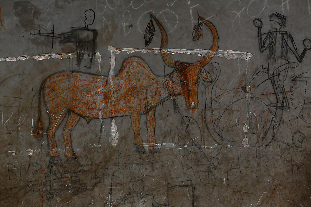 Graffitis are pictured in a administrative building in the village of Nialdhiu, South Sudan.