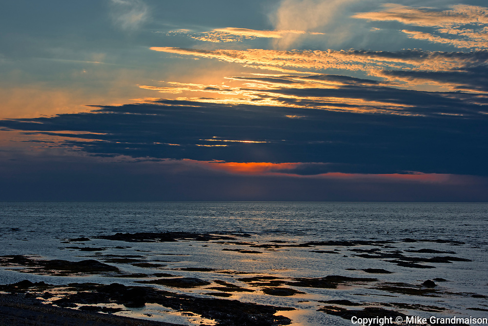 Shoreline along the Gulf of St. Lawrence at sunrise with storm<br />Mont-Louis<br />Quebec<br />Canada