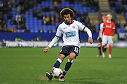 Bolton Wanderers defender, Derik Osede (15) put in the cross during the Sky Bet Championship match between Bolton Wanderers and Charlton Athletic at the Macron Stadium, Bolton, England on 19 April 2016. Photo by John Marfleet.