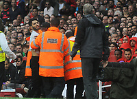 Football - 2017 Emirates Cup [pre-season friendly competition] - Arsenal vs. Benfica<br /> <br /> A fan glances over at Arsenal Manager Arsene Wenger as he is restrained by staff after running onto the pitch at The Emirates.<br /> <br /> COLORSPORT/ANDREW COWIE