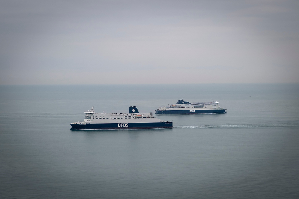 Cross channel ferries DFDS seaways pass each other outside the port of Dover, United Kingdom.  They cross the 34 kilometres (21 miles)  distance of the English Channel, one of the busiest shipping lanes in the world as they transport vehicles and cargo between the ports of Dover, England and Calais, France. (photo by Andrew Aitchison / In pictures via Getty Images)