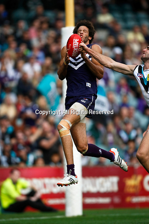 13.05.2012 Subiaco, Australia. Fremantle v Port Adelaide. Zac Clarke goes for a mark during the Round 7 game played at Patersons Stadium.