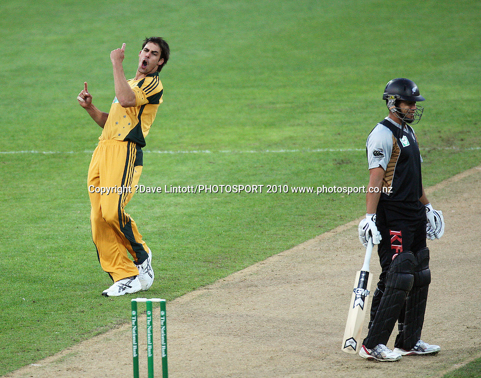 Australia's Mitchell Johnson celebrates dismissing Ross Taylor (right).<br /> 1st Twenty20 cricket match - New Zealand v Australia at Westpac Stadium, Wellington. Friday, 26 February 2010. Photo: Dave Lintott/PHOTOSPORT