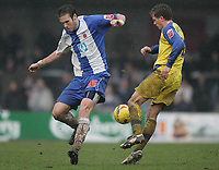 Photo: Lee Earle.<br /> Torquay United v Hartlepool United. Coca Cola League 2. 17/02/2007.Torquay's Lee Mansell (R) and Andy Monkhouse battle for the ball.