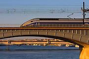 A TGV (Train Grande Vitesse) express train crossing the Rhône.