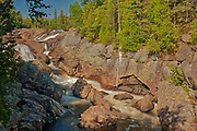 The Sand River flows over teh Sand River Falls and empties into Lake Superior<br />