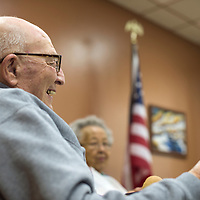 030315      Cayla Nimmo<br /> <br /> Allan Reed laughs with friends at the North Side Senior Center in Gallup Tuesday.