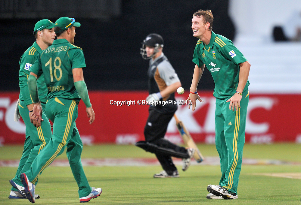 Chris Morris of South Africa celebrating with teammates during the 2012 New Zealand Tour South Africa cricket International T20 match between South Africa and New Zealand at the Kingsmead Stadium  in Durban , December 21 , 2012<br />   <br /> <br /> &copy; Sabelo Mngoma/BackpagePix
