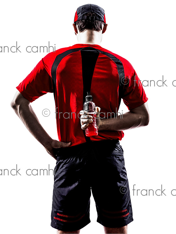 one young man runners athletes drinking energy drinks in silhouette isolated on white background