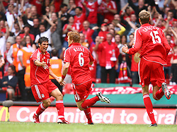 CARDIFF, WALES - SUNDAY, AUGUST 13th, 2006: Liverpool's John Arne Riise celebrates scoring the opening goal against Chelsea with his team-mate Mark Gonzalez during the Community Shield match at the Millennium Stadium. (Pic by David Rawcliffe/Propaganda)