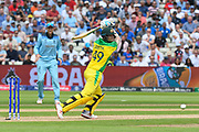 Steve Smith of Australia hits the ball to the boundary for four runs during the ICC Cricket World Cup 2019 semi final match between Australia and England at Edgbaston, Birmingham, United Kingdom on 11 July 2019.