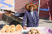 Bread seller, Marrakech medina, Morocco, 2017–11-06.