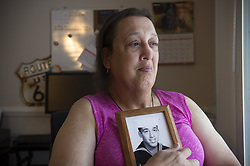 July 27, 2017 - Marietta, Georgia, U.S. - MONICA HELMS, 66, served eight years in the U.S. Navy on submarines in the 1970s before coming to terms with her true gender identity and transitioning from lake to female. She created a pink blue and white flag to represent the transgender community in 1999 and the flag is now internationally recognized. She is an outspoken acticitst for transgender rights. Monica is pictured in her townhouse north of Atlanta with photograph of herself as a young sailor. (Credit Image: © Robin Rayne Nelson via ZUMA Wire)