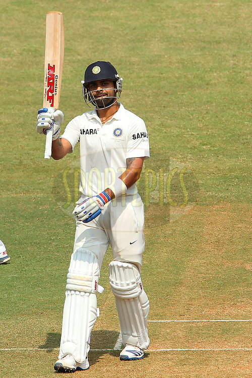 Virat Kholi of India celebrates his fifty during day two of the second Star Sports test match between India and The West Indies held at The Wankhede Stadium in Mumbai, India on the 15th November 2013<br /> <br /> This test match is the 200th test match for Sachin Tendulkar and his last for India.  After a career spanning more than 24yrs Sachin is retiring from cricket and this test match is his last appearance on the field of play.<br /> <br /> <br /> Photo by: Ron Gaunt - BCCI - SPORTZPICS<br /> <br /> Use of this image is subject to the terms and conditions as outlined by the BCCI. These terms can be found by following this link:<br /> <br /> http://sportzpics.photoshelter.com/gallery/BCCI-Image-Terms/G0000ahUVIIEBQ84/C0000whs75.ajndY