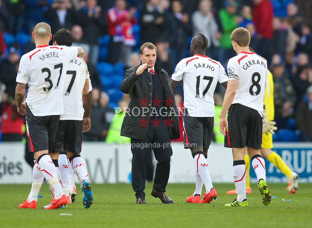 CARDIFF, WALES - Saturday, March 22, 2014: Liverpool's manager Brendan Rodgers and captain Steven Gerrard after the 6-3 victory over Cardiff City during the Premiership match at the Cardiff City Stadium. (Pic by David Rawcliffe/Propaganda)
