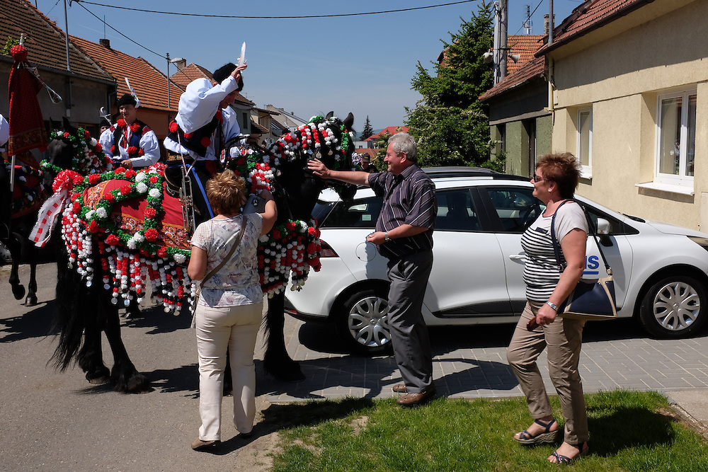 Riders in Kunovice, Czech Republic, collecting gifts for entertaining the residents at the Jizda Kralu, Ride of the Kings.