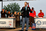 Official adjudicator Philip Robertson announces Smithfield setting the Guinness World Records title for Largest grilling lesson on Thursday, April 27, 2017, in Kansas City, Mo. Photo by Colin E. Braley for Smithfield