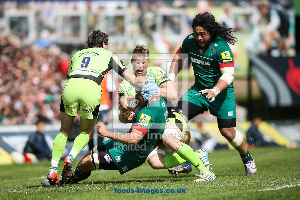 James Craig of Northampton Saints (centre) brings down Jordan Crane of Leicester Tigers (lower centre) during the Aviva Premiership match at Welford Road, Leicester<br /> Picture by Andy Kearns/Focus Images Ltd 0781 864 4264<br /> 16/05/2015