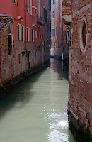 A canal winding through the old buildings of Venice, Italy.