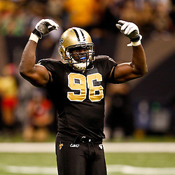 Oct 31, 2010; New Orleans, LA, USA; New Orleans Saints defensive end Alex Brown (96) pumps up the crowd during the second half of a game against the Pittsburgh Steelers at the Louisiana Superdome. The Saints defeated the Steelers 20-10.  Mandatory Credit: Derick E. Hingle
