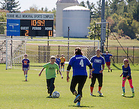 Brenden Baron takes control of the ball during the Elm Street School Faculty / Student soccer match held Sunday morning at Robbie Mills Field.  (Karen Bobotas/for the Laconia Daily Sun)