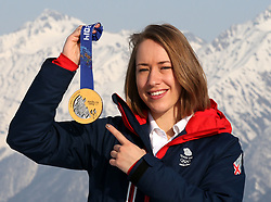 File photo dated 16-02-2014 of Great Britains Lizzy Yarnold with her gold medal high above the mountains above Rosa Khutor after winning the womans Skeleton during the 2014 Sochi Olympic Games