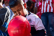 Jessie Fashen blows up a balloon to hold up with other members of the Union Ultras supporters group during the final game of the Chivas USA franchise at the StubHub Center in Carson, Calif., on Oct. 26, 2014. Chivas USA defeated the San Jose Earthquakes 1-0.
