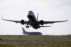 © Licensed to London News Pictures. 07/06/2017. Leeds UK. A Ryan Air aircraft struggles to take off in heavy winds at England's highest airport, Leeds Bradford airport today. Photo credit: Andrew McCaren/LNP