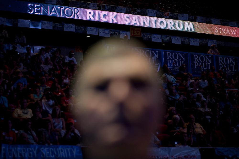 A man listens to Republican presidential hopeful Rick Santorum at the Iowa Republican Straw Poll on Saturday, August 13, 2011 in Ames, IA.