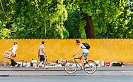 A cyclist by the colourful roadside in Nørrebro Copenhagen.