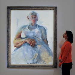 """© Licensed to London News Pictures. 17/11/2017. London, UK.  London, UK.  17 November 2017. A staff member views """"Cultural Fetish"""", 1992, by Jenny Saville (GBP 120-180k).  Preview upcoming auctions of Modern & Post War British Art and Scottish Art taking place at Sotheby's, New Bond Street, on 21 and 22 November. Photo credit: Stephen Chung/LNP"""