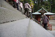 stairs at an temple complex with elderly people going down Japan