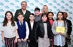 Hugh Bonneville and Edith Bowman present Meadows Primary students with the award for Best Documentary during the fifth annual Into Film Awards, held at the Odeon Luxe in Leicester Square, London.