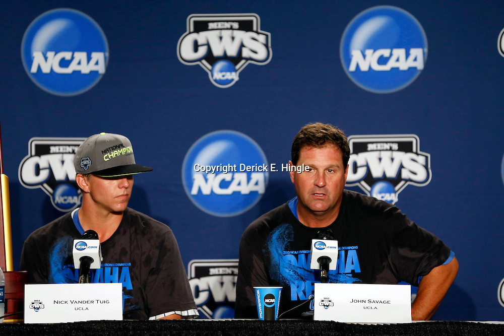 Jun 25, 2013; Omaha, NE, USA; UCLA Bruins starting pitcher Nick Vander Tuig (left) and head coach John Savage (right) address the media in a press conference after game 2 of the College World Series finals against the Mississippi State Bulldogs at TD Ameritrade Park. UCLA defeated Mississippi State 8-0. Mandatory Credit: Derick E. Hingle-USA TODAY Sports