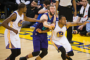 Charlotte Hornets forward Spencer Hawes (00), Golden State Warriors forward Kevin Durant (35), and forward Andre Iguodala (9) battle for a rebound during a free-throw at Oracle Arena in Oakland, Calif., on February 1, 2017. (Stan Olszewski/Special to S.F. Examiner)