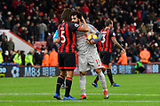 Nathan Ake (5) of AFC Bournemouth hugs hatrick hero Mohamed Salah (11) of Liverpool at full time after a 4-0 win over Bournemouth during the Premier League match between Bournemouth and Liverpool at the Vitality Stadium, Bournemouth, England on 8 December 2018.