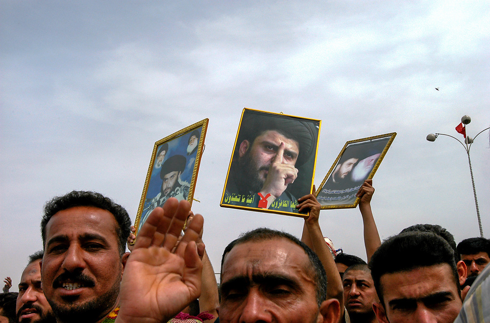 Thousands of supporters of Shia leader Moktada al-Sadr and his organization al-Hawsa pray in front of the headquarters of the US civilian administration in Iraq to protest the decison to close the oraganization's newspaper al-Hawsa Anatika for inciting violence.  <br /> Baghdad, Iraq. 02/04/2004