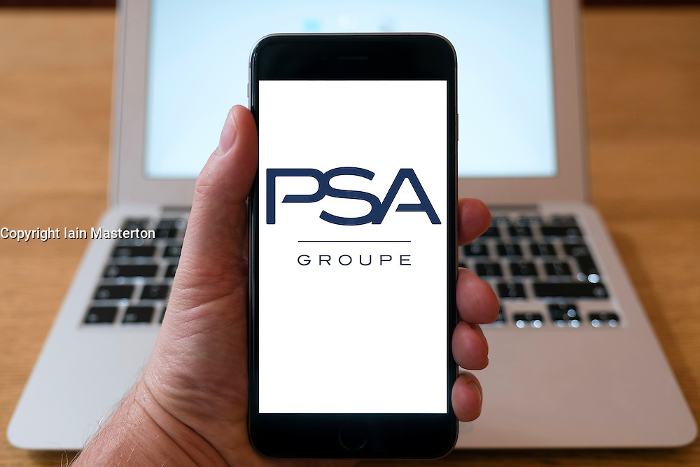 PSA Groupe motor manufacturing group logo on smart phone screen.