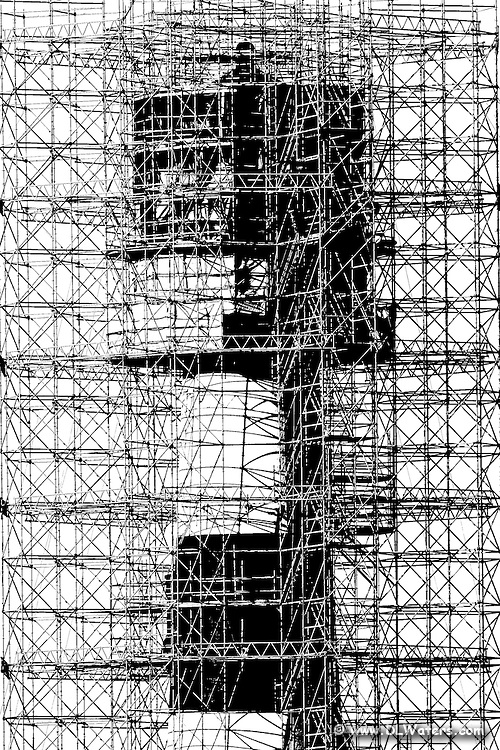Scaffolding covers body Island lighthouse.  High contrast black and white photograph.