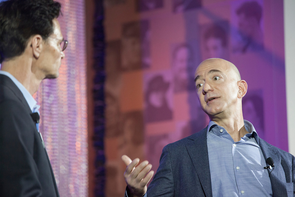 October 11, 2013 - Seattle, Washington, United States: Amazon.com Founder and CEO Jeff Bezos (R) speaks with Leonard Garfield (L), Executive Director of the Museum of History and Industry (MOHAI), during a launch event for the Bezos Center for Innovation at MOHAI. Bezos is also the owner of The Washington Post and founder of Blue Origin.