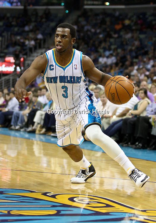 April 8, 2011; New Orleans, LA, USA; New Orleans Hornets point guard Chris Paul (3) against the Phoenix Suns during the first quarter at the New Orleans Arena.  Mandatory Credit: Derick E. Hingle
