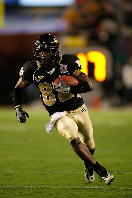 Wake Forest University wide receiver Willie Idlette runs upfield after catching a pass during the Louisville Cardinals 24-13 victory over the Wake Forest Demon Deacons at the 2007 Orange Bowl Game on January 2, 2007 at the Dolphin Stadium in Miami, Florida.