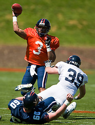 Virginia quarterback Riko Smalls (3) throws over Virginia linebacker Brady Stovall (39).  The Virginia Cavaliers football team played the annual spring football scrimmage at Scott Stadium on the Grounds of the University of Virginia in Charlottesville, VA on April 18, 2009.  (Special to the Daily Progress / Jason O. Watson)
