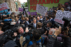 "Smith Square, Westminster, London, June 16th 2016. UKIP leader Nigel Farage launches his ""biggest ever"" advertising campaign as Leave and Remain enter their last week of campaigning before the EU referendum on June 23rd. PICTURED: Remain counter-campaigners disrupt UKIP's launch as Farage speaks to the media."