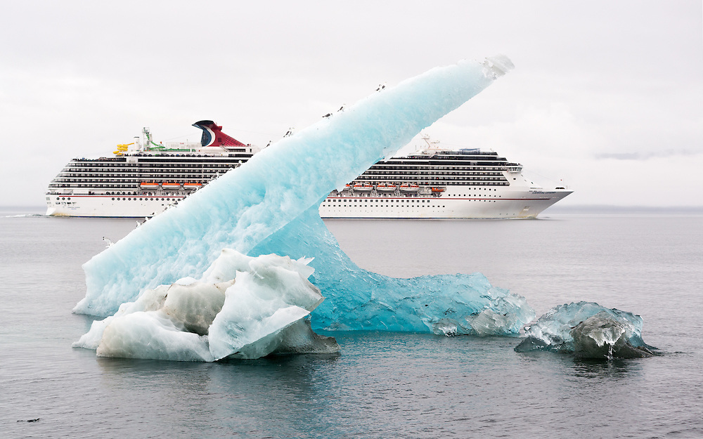 Carnival Legend cruise ship and an iceberg with gulls in Stephen's Passage, Alaska.