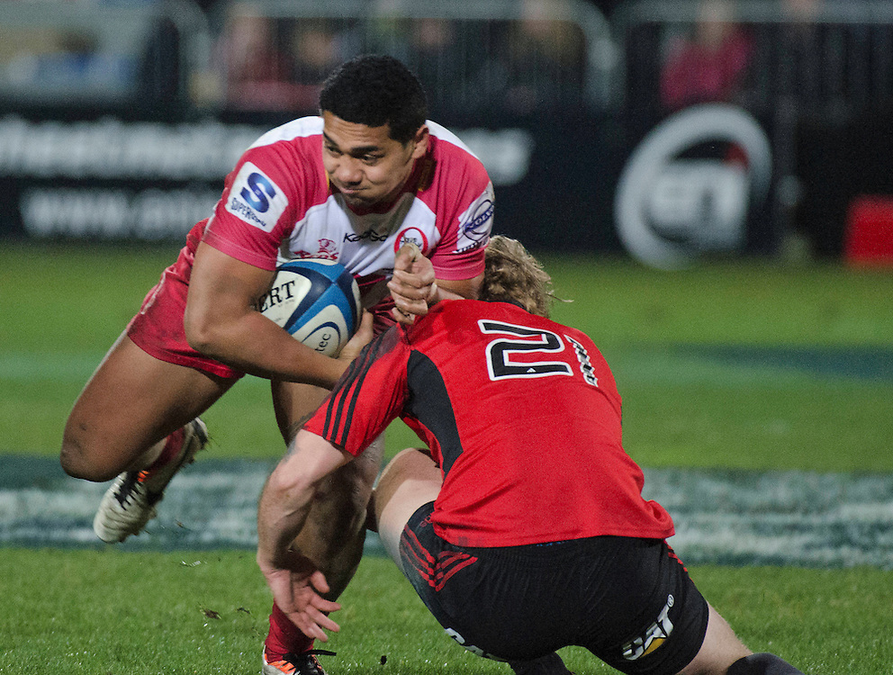 Reds Chris Feauai-Sautia is tackled by Crusaders Tyler Bleyendaal in the Super Rugby qualifier match at AMI Stadium, Christchurch, New Zealand, Saturday, July 20, 2013. Credit:SNPA / David Alexander
